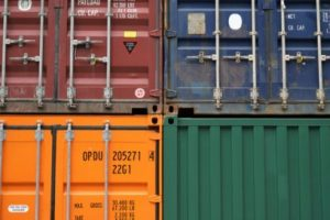 green and orange shipping containers up close